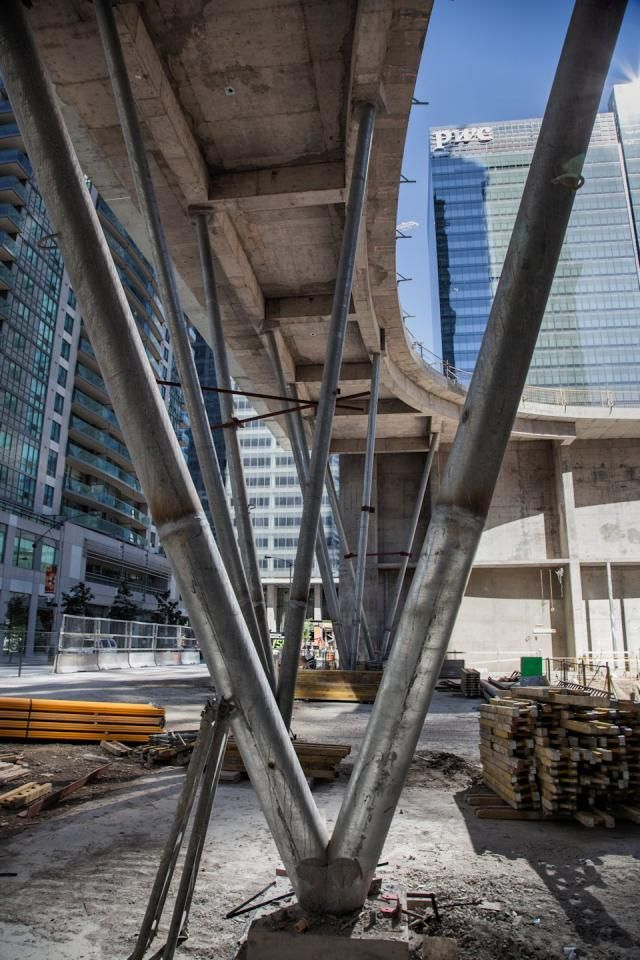 Architectural Support Posts : Angled steel support columns on ice condos ground floor