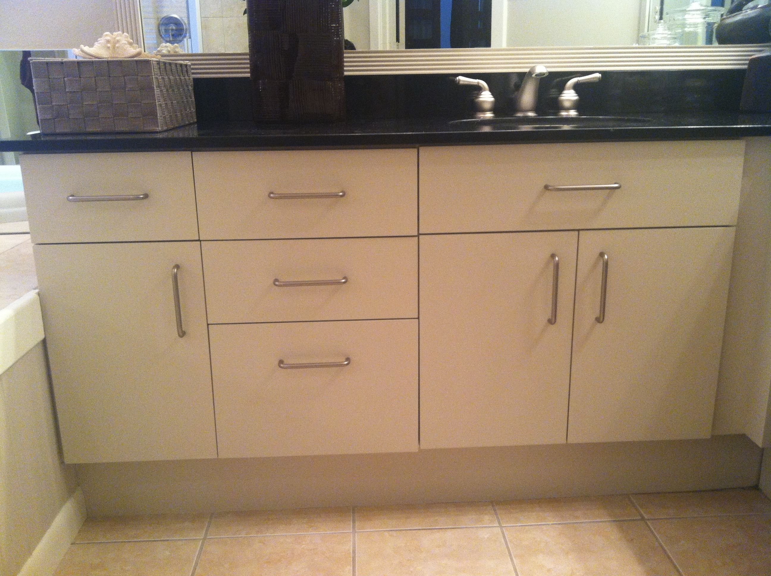 I updated these melamine cabinets using Rust-Oleum's ...
