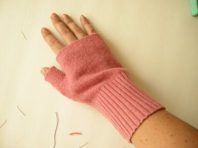 Fingerless gloves from old sweaters. BRILLIANT! I am so doing this ...