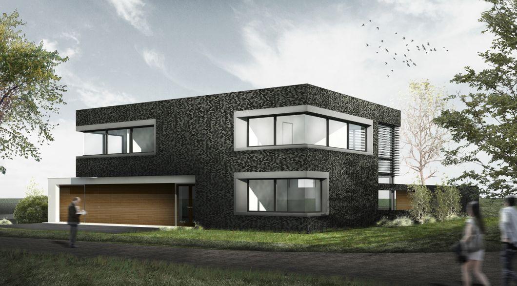 Moderne woning platdak twee verdiepingen zwart metselwerk gevel