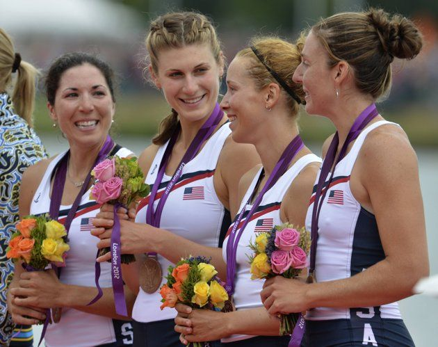 Day 5 - Bronze medallist from L to R: Natalie Dell, Kara Kohler, Megan Kalmoe and Adrienne Martelli of the U.S. pose during the victory ceremony after the women's quadruple sculls Final A at Eton Dorney during the London 2012 Olympic Games August 1, 2012. REUTERS/Eric Feferberg/Pool