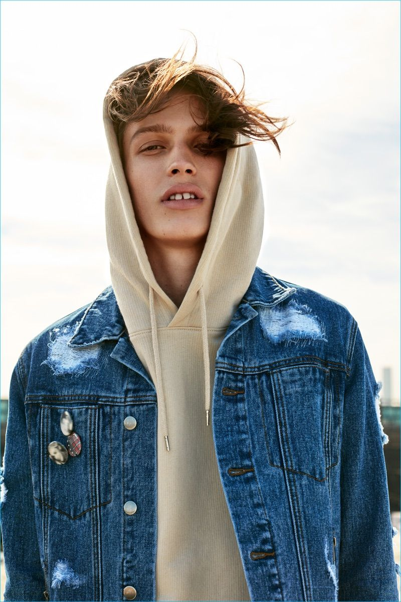09f100a2ca7f Lucas Satherley sports a denim jacket with a casual hoodie for Forever 21 s  fall 2016 campaign.
