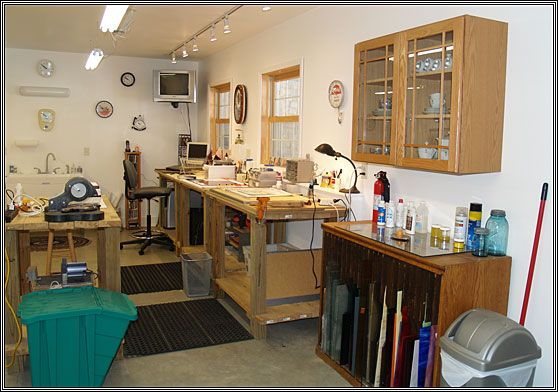 A neat & tidy stained glass studio space. A bit clinical, but still nice.