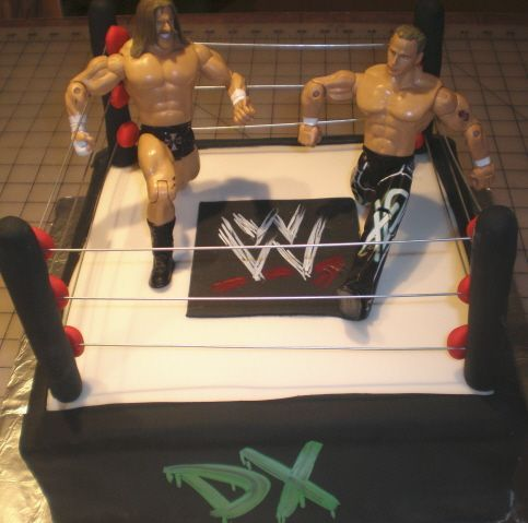 Wrestling cake - This was a simple cake. Mom supplied figures. I just thought it turned out really neat. WWE emblem and DX hand painted.