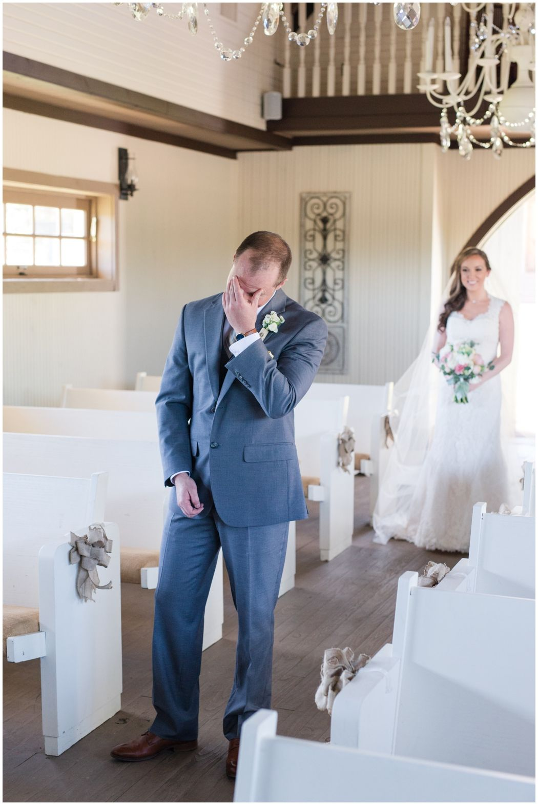First Look in Little White Chapel with burlap church pews at Yellow Wedding at twisted ranch near Austin, texas