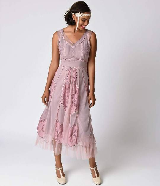 We hope you're comfortable with compliments, dear. A heavenly 1930s inspired dress from Nataya, in a delicate embroidered light purple tulle set against purple muslin with tulle hem for a refined, feminine look. Boasting stunning lace work throughout, a s