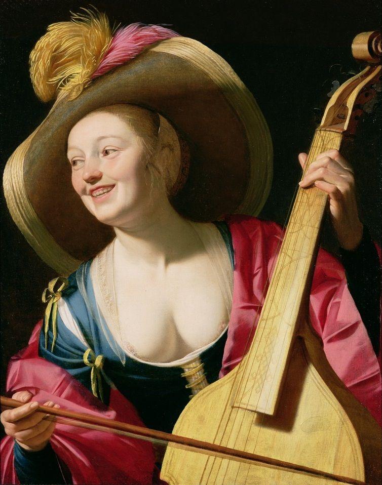 """A young woman playing a viola da gamba"". Gerrit van Honthorst. (c. 1630)"