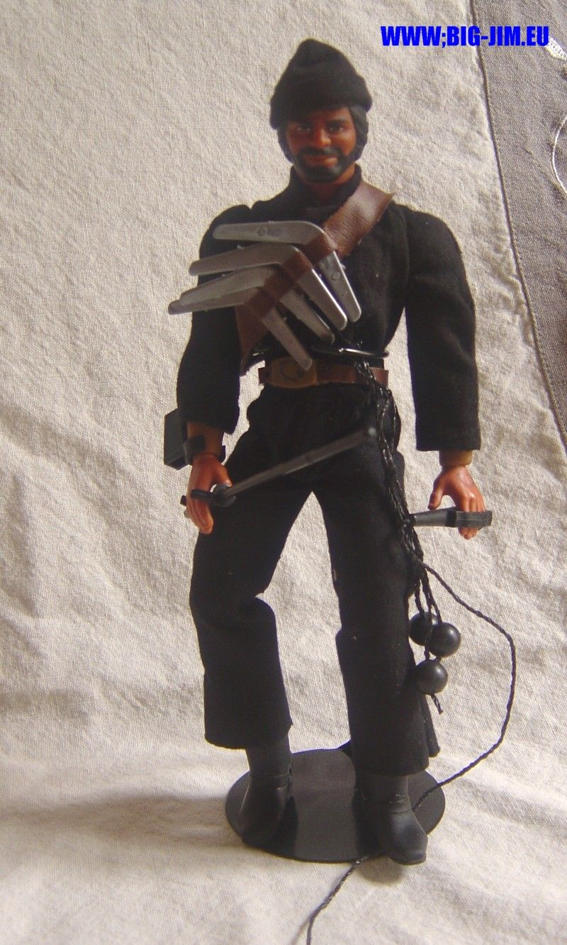Boomerangs, fancy hat, whip....he must be from OZ. The Whip, action figure Big Jim Mattel