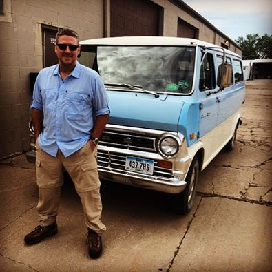 Joe Cross on an Iowa farm with his wheels... I love this pic.... At least the van is blue! He looks great in blue, no matter what year. lol