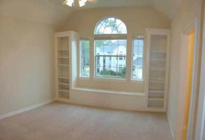 Built in bookshelves around window seat this for Bedroom window seat