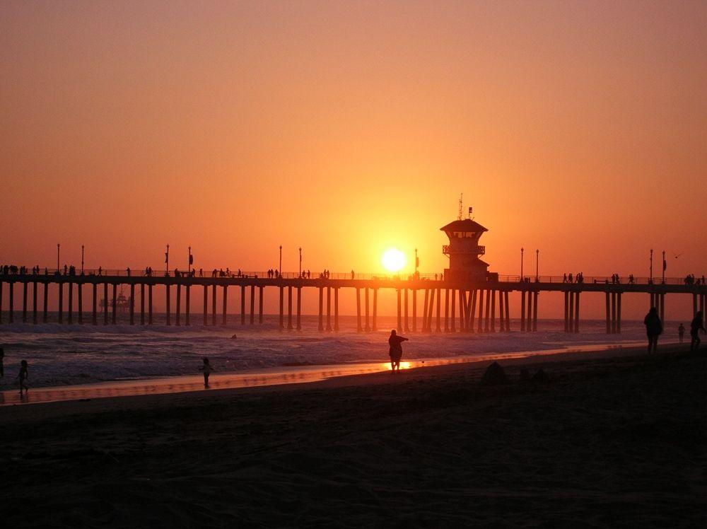 Sunset over Huntington Beach, California: http://beachthursday.com/photos/sunset-huntington-beach/