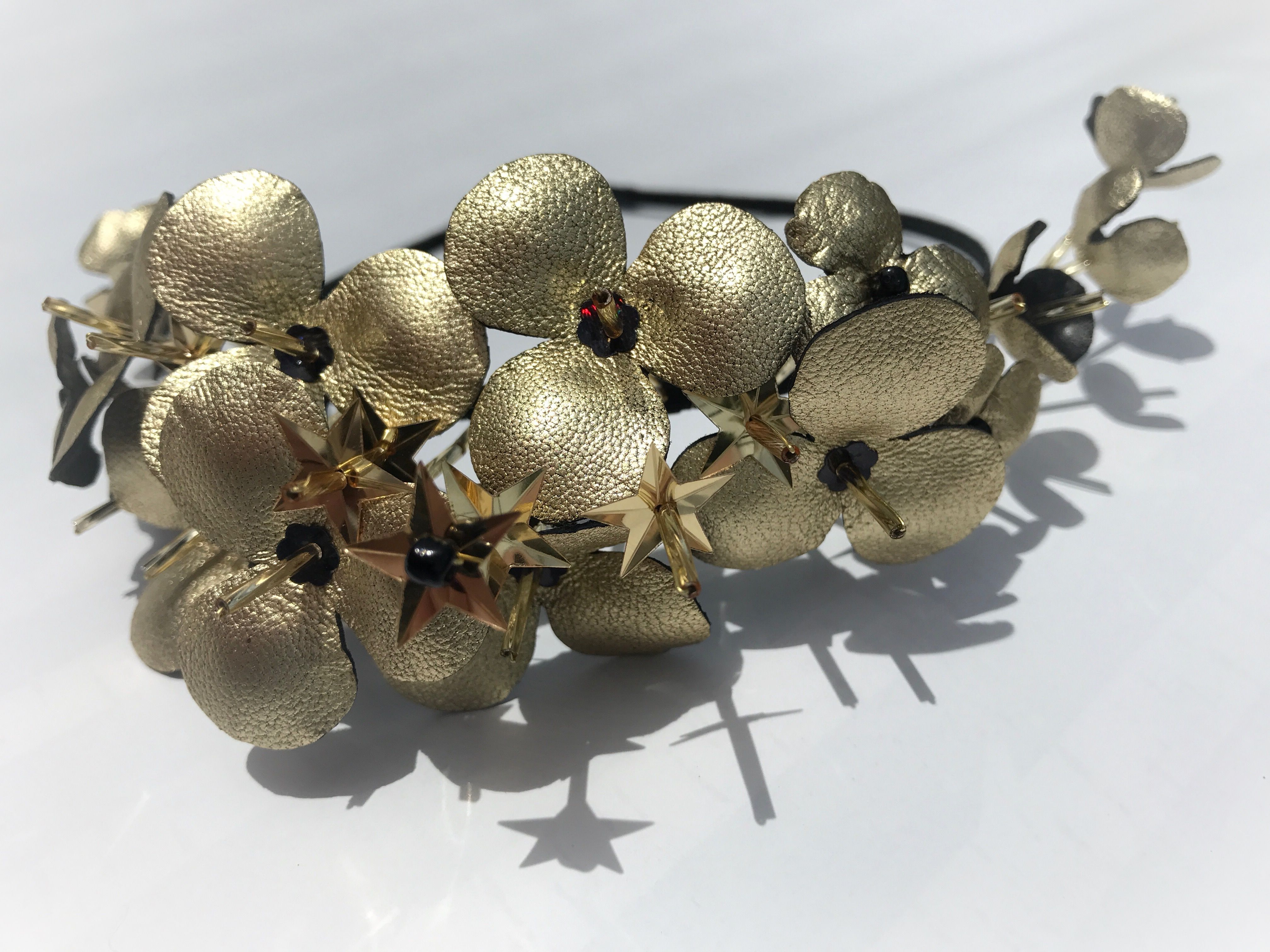 gold stars floral crown. derby headbands, myer. gold leather