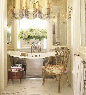 Silk Shades - Make your bathroom a luxurious retreat with a silk shade window treatment. The golden hues of this shade work perfectly in the feminine bathroom adorned with gold-colored walls and soft lighting. Hang the valance from the ceiling rather than the top of the window to ensure that the beauty of the silky shade can be enjoyed by all who enter the elegant bath