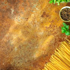 pasta raw spaghetti or bucatini and tomato sauce ingredients food background copy space