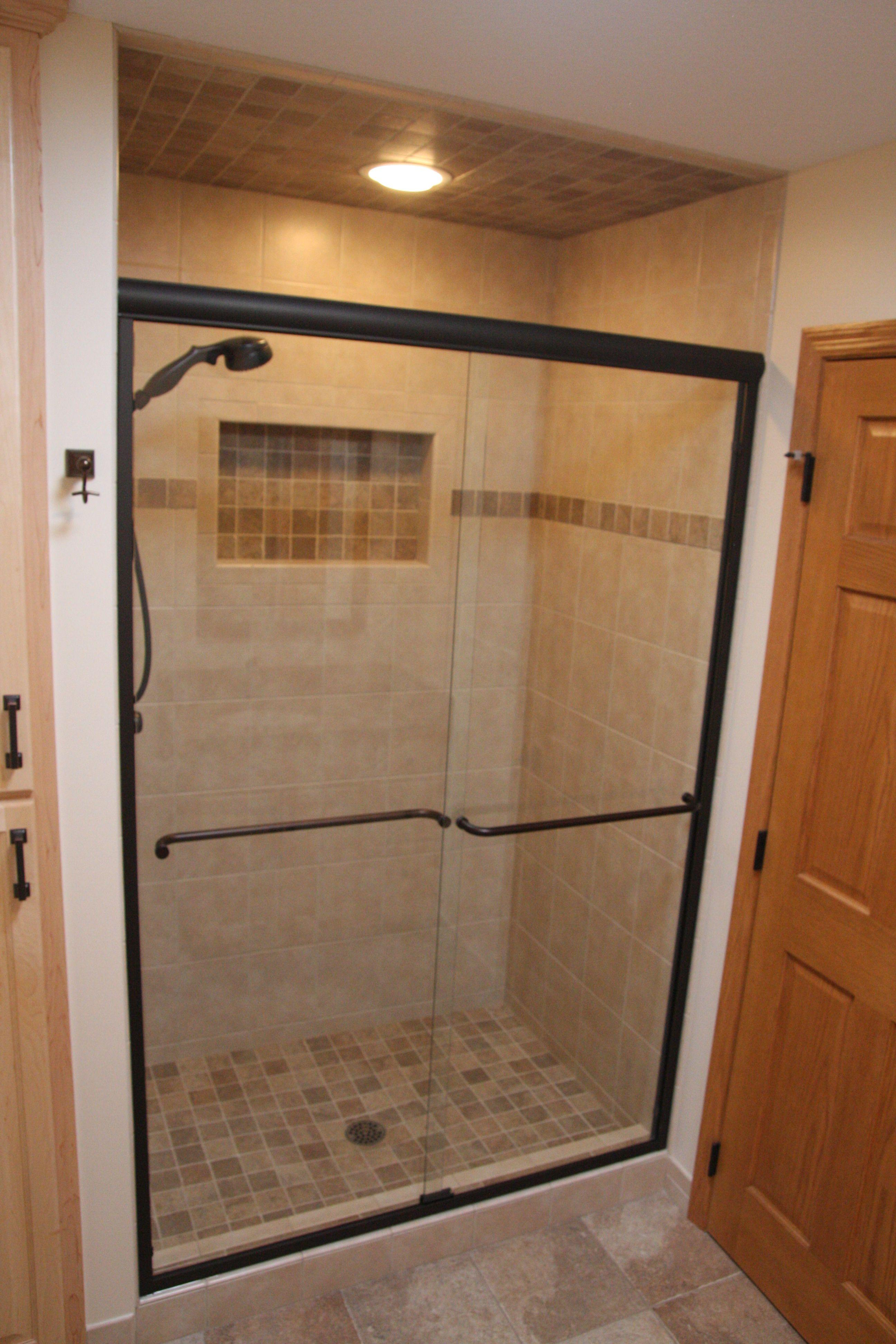 Custom tile shower with tile insert & glass shower doors | Bathroom ...