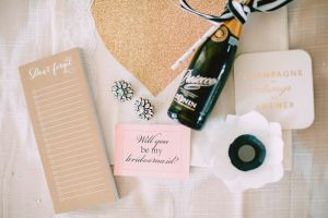 """Now that you've had an inside peek at my """"Bridesmaid Ask Brunch,"""" it's time to share the DIY details! On each girl's seat I tied a handmade giftbag filled with a mini bottle of bubbly, festive coasters, a to-do list note"""