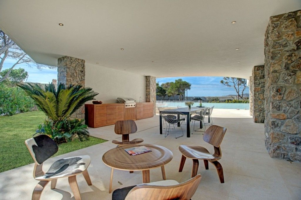 Villa U0026 Resort: Contemporary Midcentury Terrace Patio With Stone Clad Wall  Siding And Eclectic Wooden Chairs Also Contemporary Wooden Round Coffe  Table ...