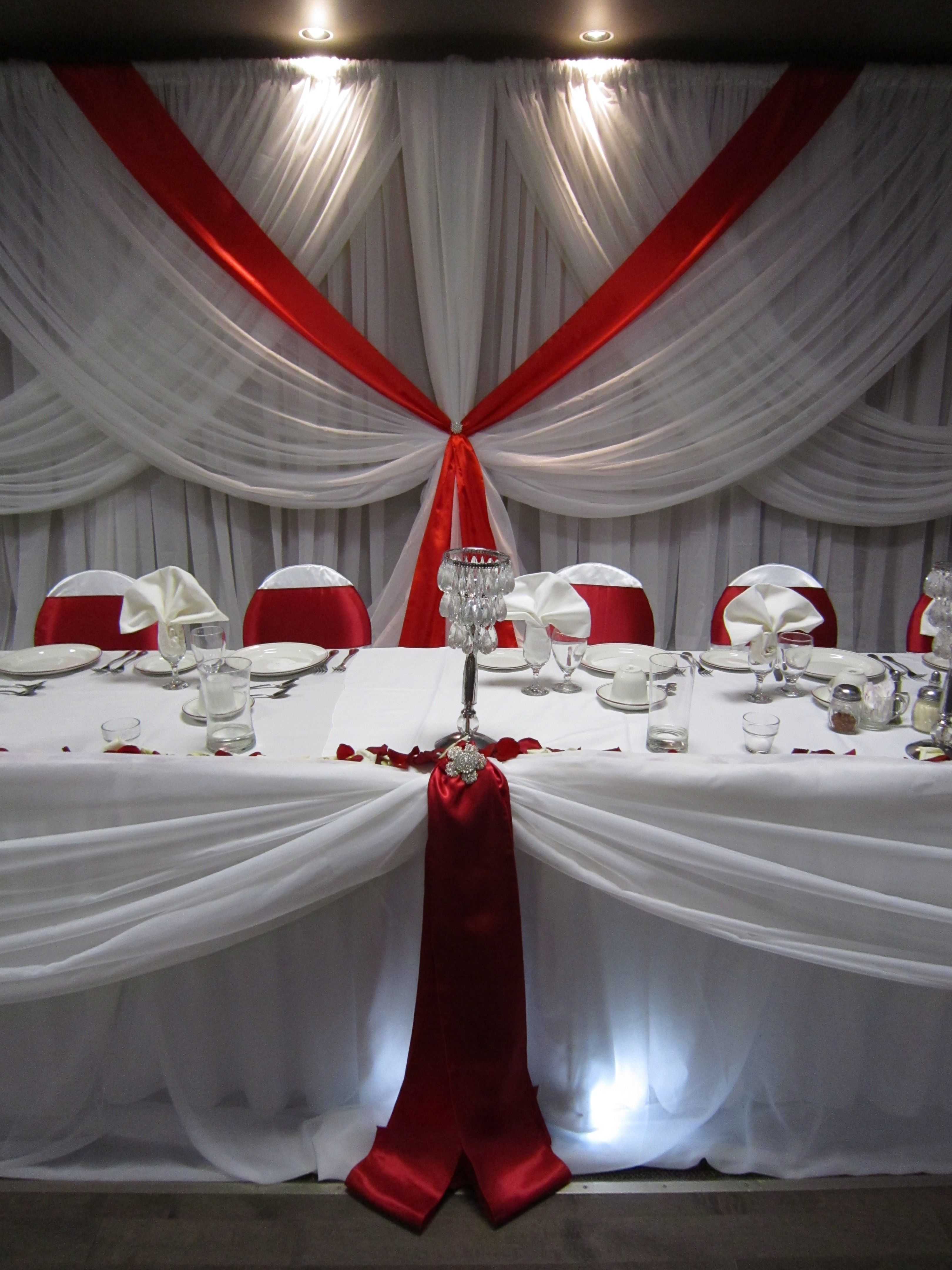 Red and white fall wedding backdrop and head table with lights ...