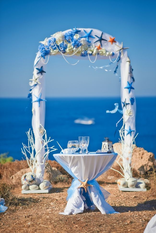 Beach theme wedding beautifully decorated wedding arch for Arches decoration ideas