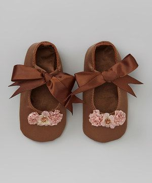 Worthy of cherishing now and as a future keepsake, these itty-bitty Mary Janes radiate the sweetness of childhood style. Delicate blossoms give the ribbon-tied pair plenty of charm and enchantment.