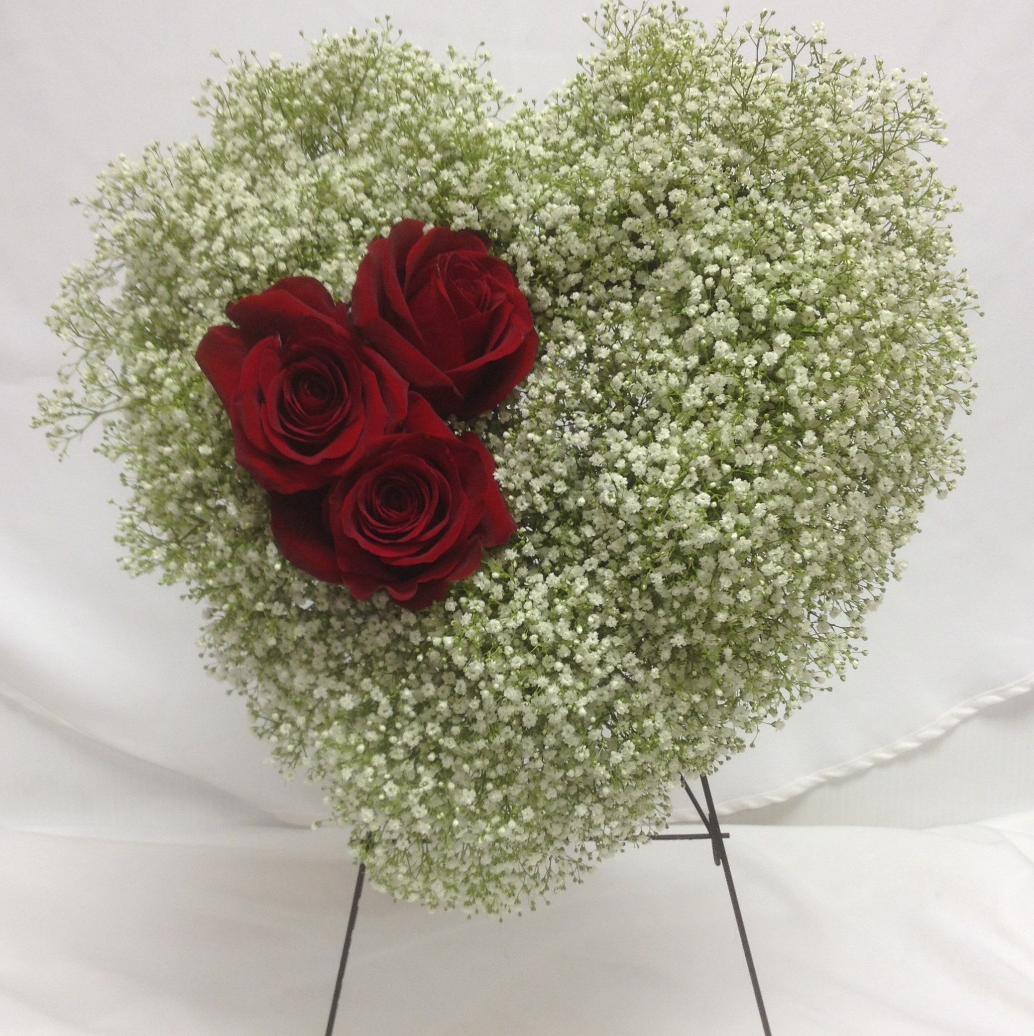 A small yet beautiful heart of babies breath with large red roses order flowers safely and securely online from summerhill florist ltd our arrangements are artfully designed with fresh flowers and hand delivered izmirmasajfo