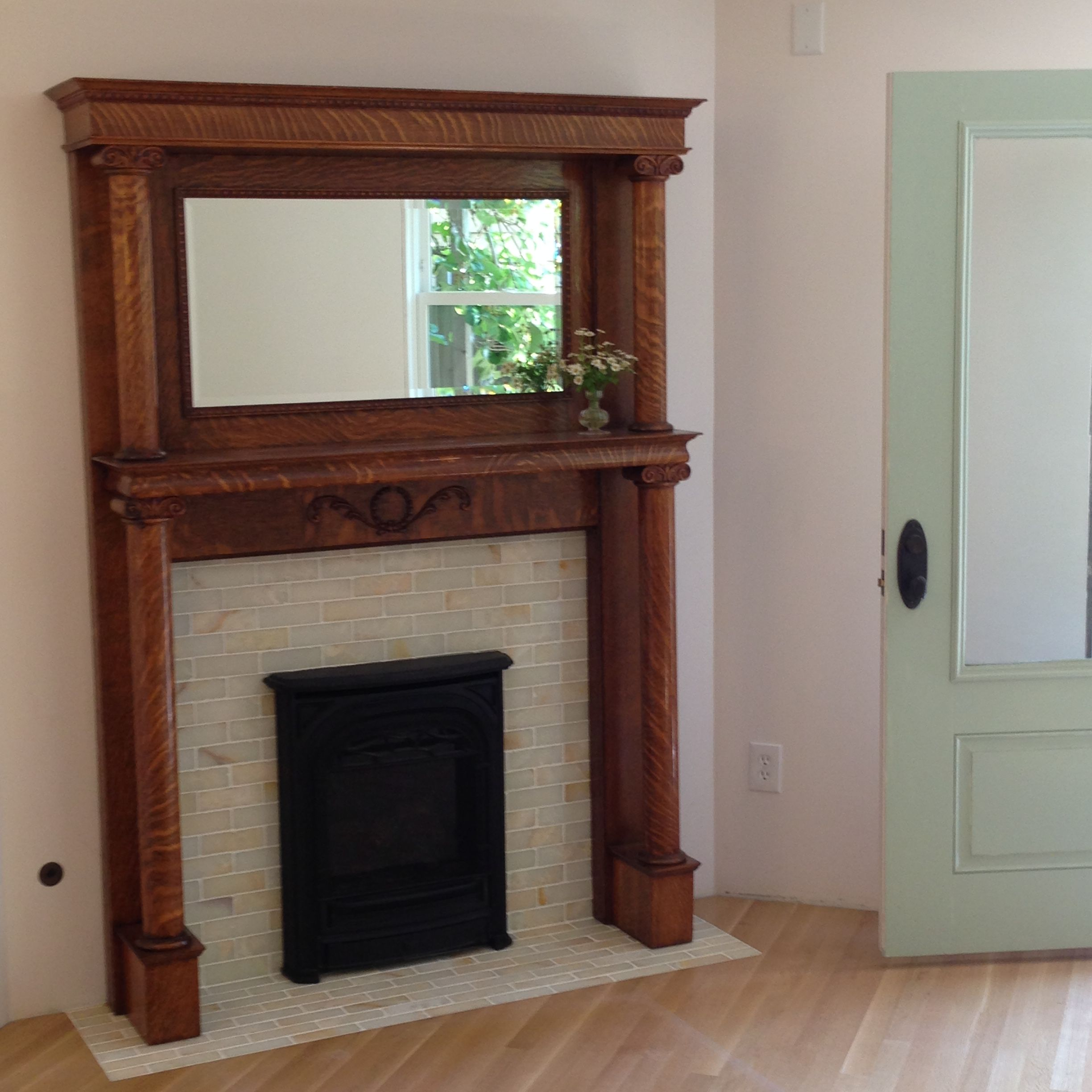 Antique Victorian oak fireplace mantle with onyx tile surround and