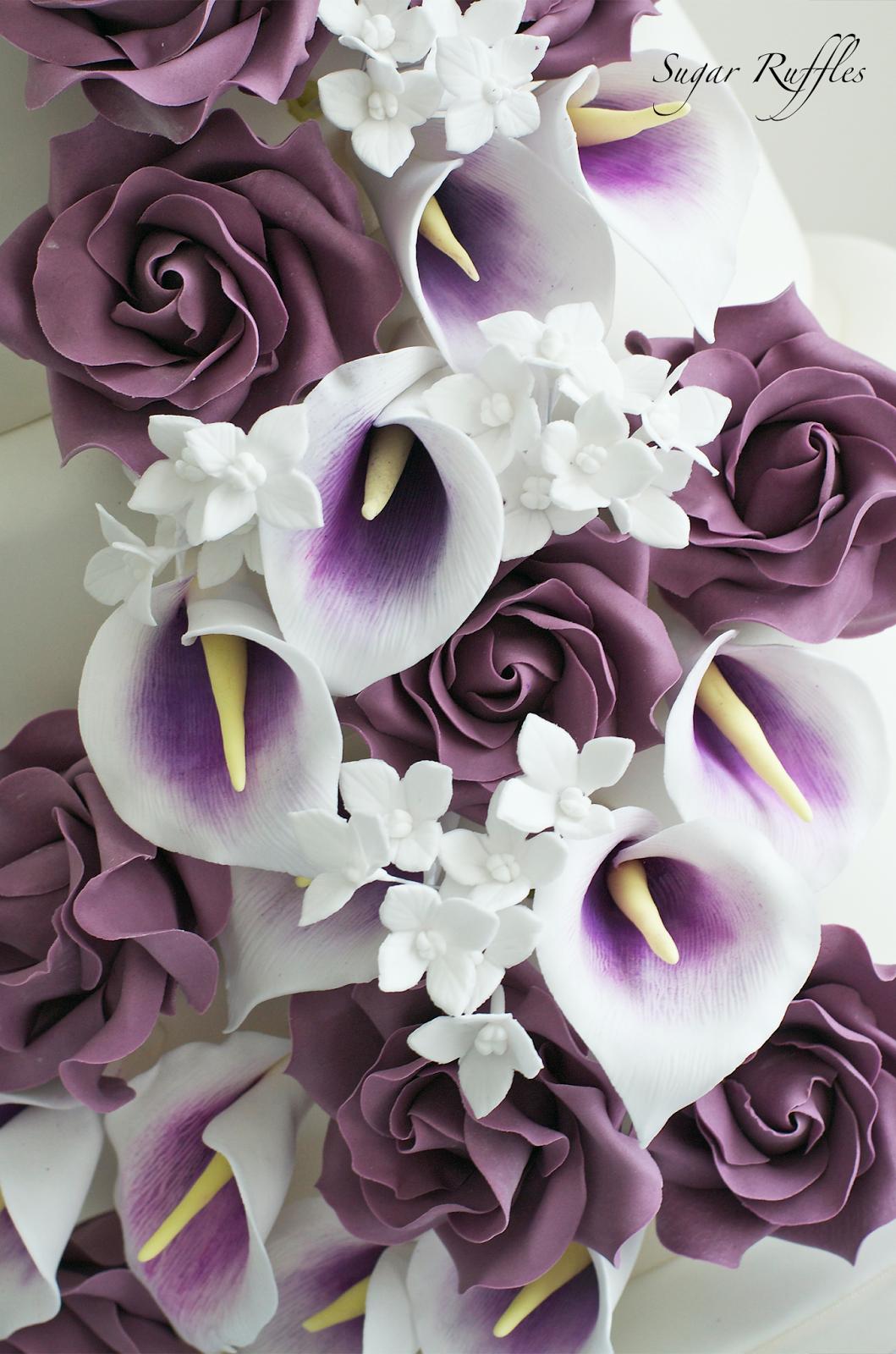 Close Up Of The Cascading Sugar Flowers Including Deep Purple Roses Picasso Ca Wedding Cake Toppers Unique Wedding Cake Decorations Wedding Cake Fresh Flowers