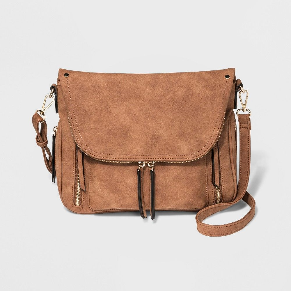 Brown crossbody purse with flap zipper pocket that buttons