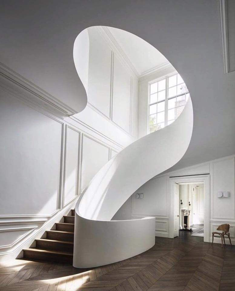The staircase shows a prime example of curved lines, as ...