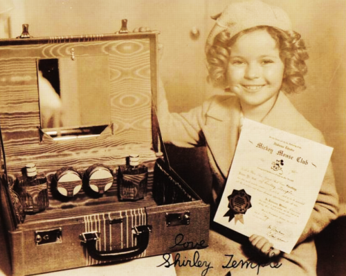 Shirley Temple with a letter from The Mickey Mouse Club, 1930s.