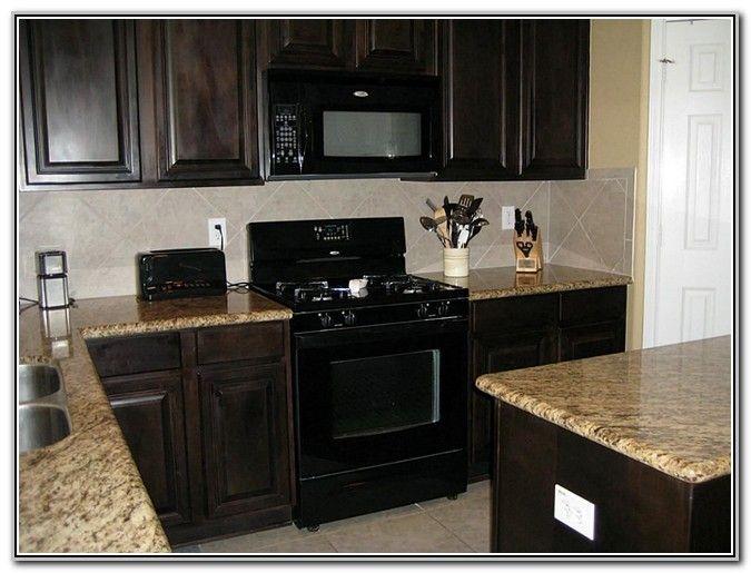 Dark Wood Cabinets With Black Appliances Odguinz Home