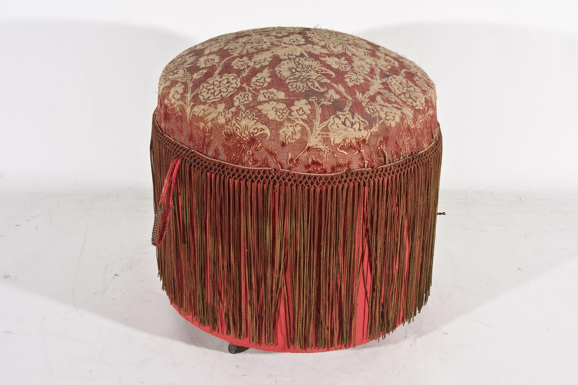 Le±era en forma de taburete circular tapizada con yute carmn floreada Del almohadillado