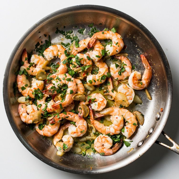 Translation: Garlic shrimp. Which explains why there's a clove of garlic for every shrimp in this saucy dish.