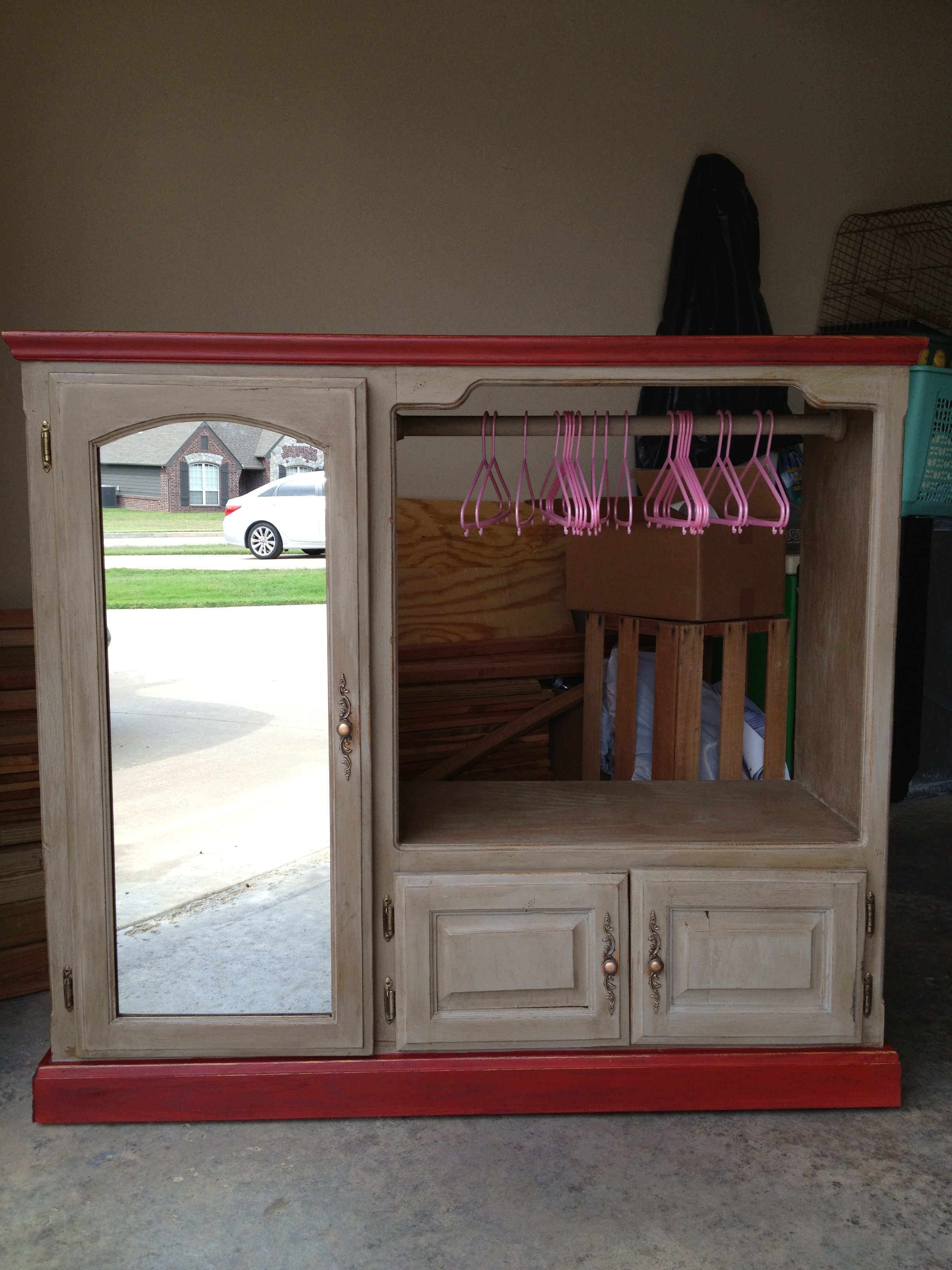 Old Entertainment Center Repurposed Into A Little Girls Dress Up Armoire.  Fun!