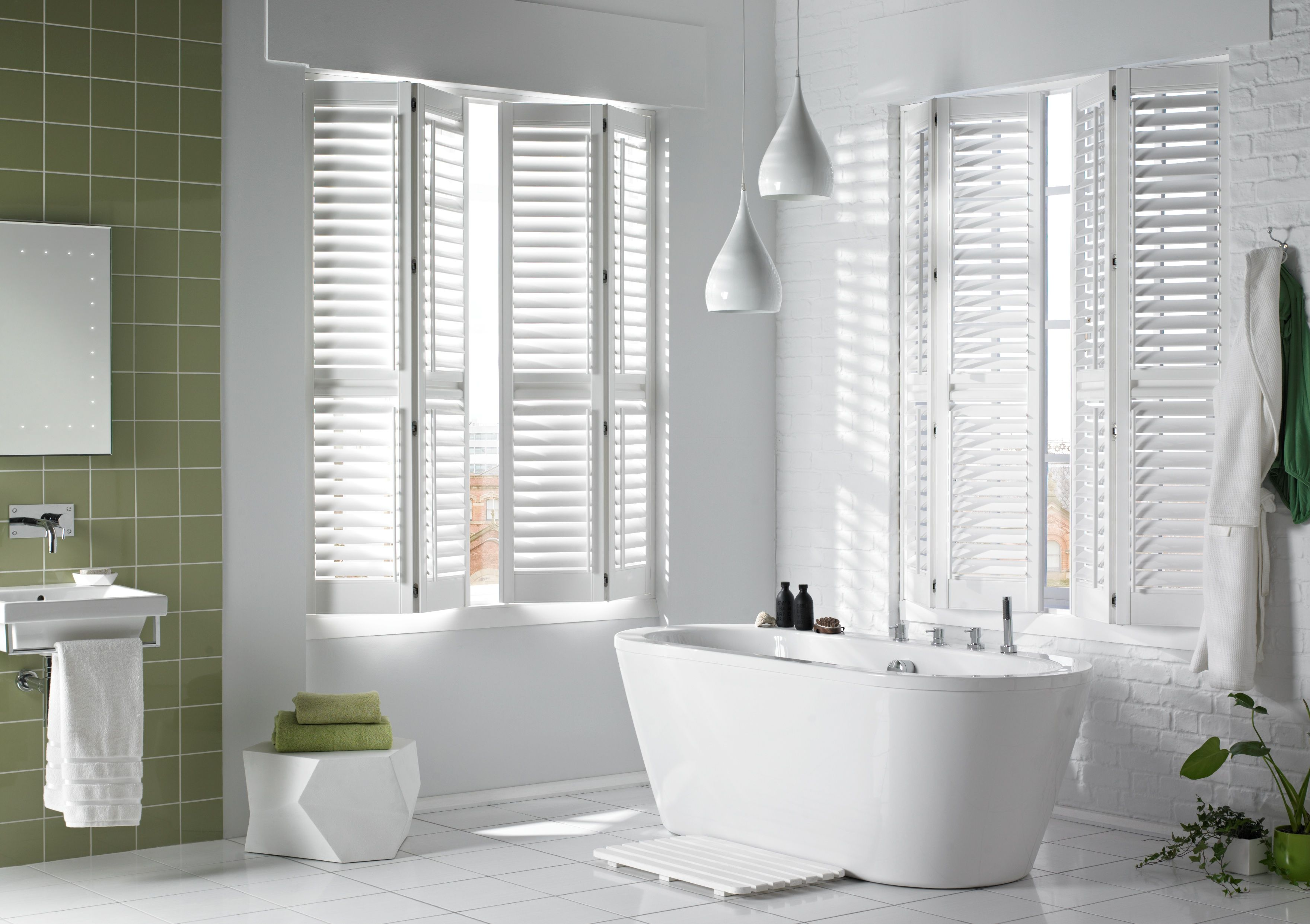 Bathroom with white vinyl shutters