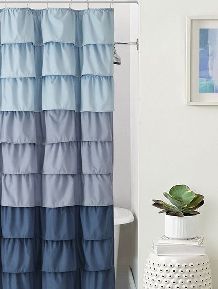 This ruffled blue ombre shower curtain adds a hint of whimsy to ...