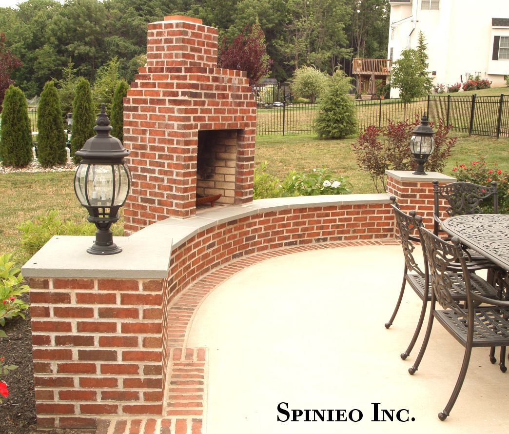 Brick Style Outdoor Fireplace Bluestone Capped Sitting Wall And A Brick Border Inlaid Around A Concrete Patio All Installe Brick Patios Patio Concrete Patio