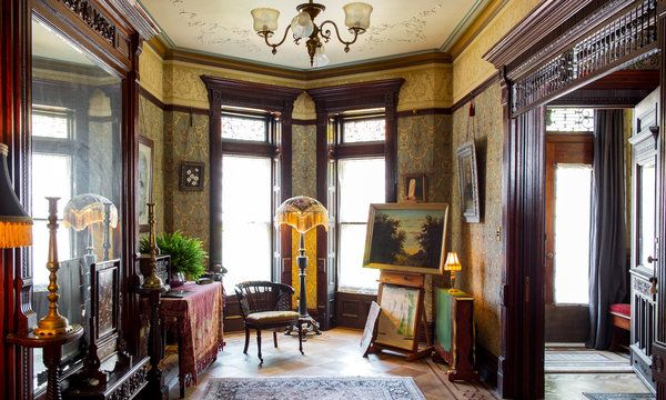 With its ornate wallpaper, wood paneling and Aesthetic Movement furniture, this room resembles a fusty Victorian interior preserved in amber