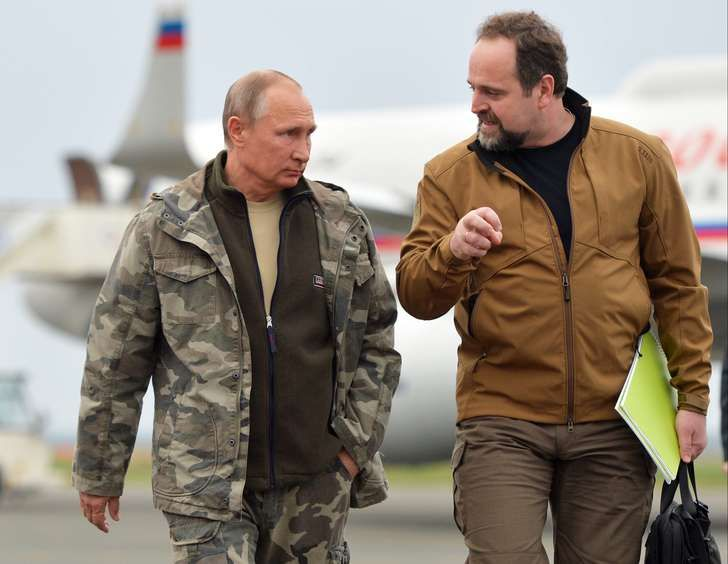 Russian President Vladimir Putin, left, walks with Minister of Natural Resources and Environment Sergei Donskoi on arrival in the Urals city of Orenburg, about 1300 kilometers (800 miles) southeast of Moscow, Russia, Monday, Oct. 3, 2016.