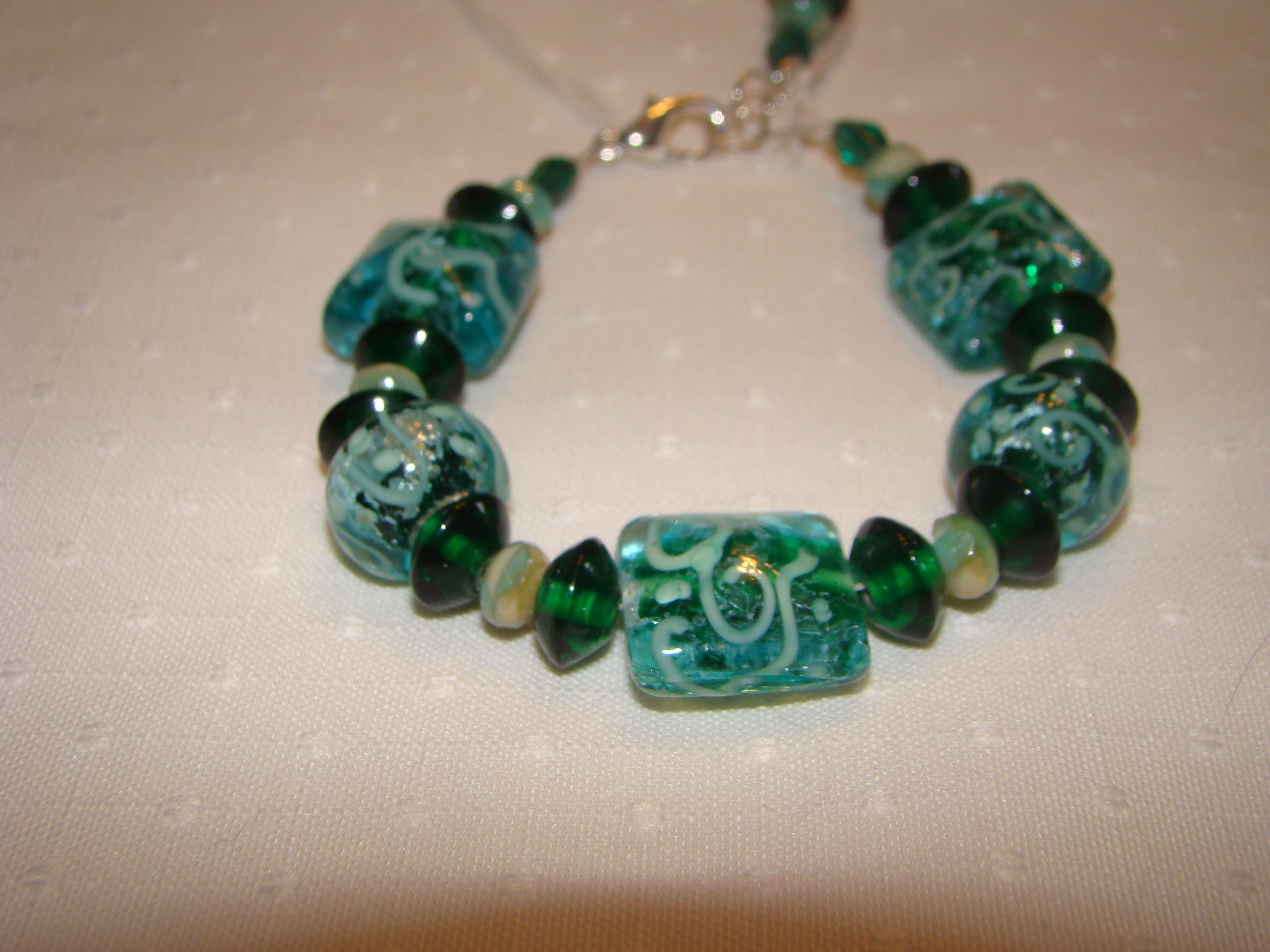 Green and teal glass  lampwork  bracelet.  Handmade by Bonnie Norberg