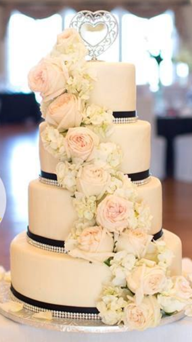 4 tier round buttercream wedding cake with fresh roses and hydrangea ...