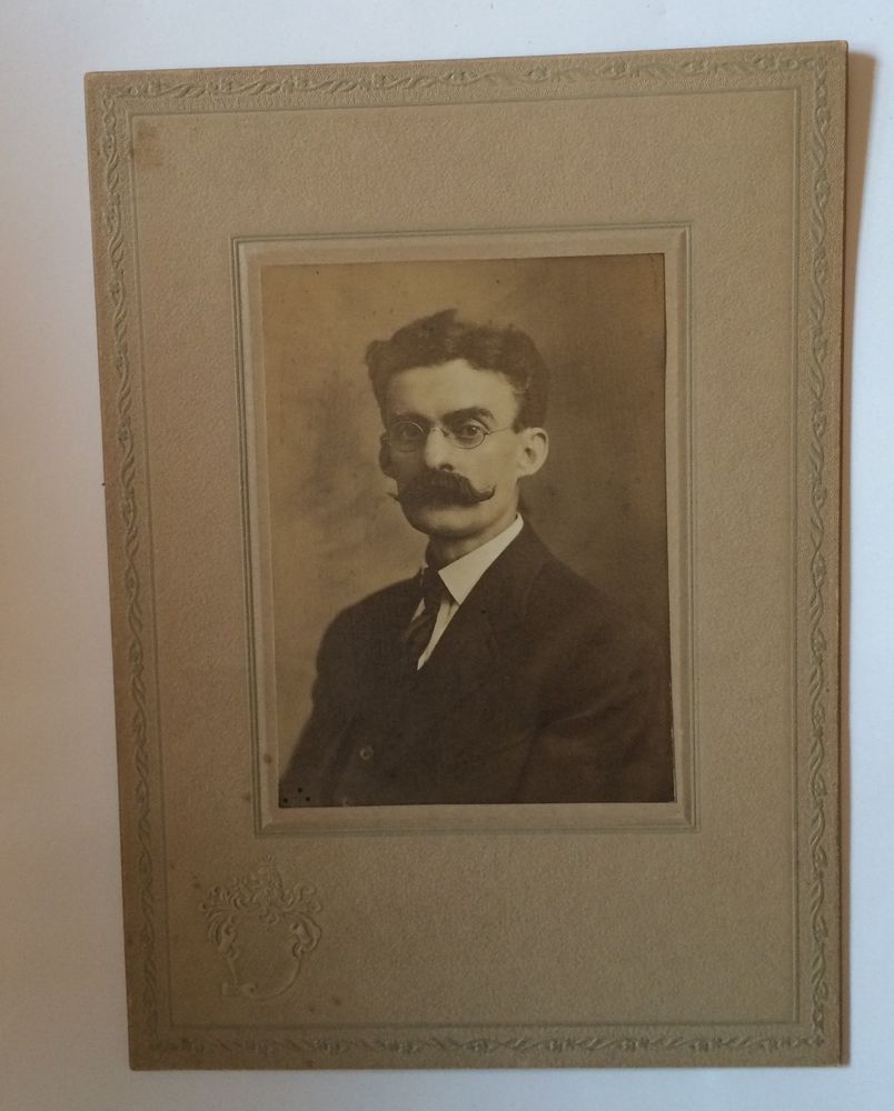 Card photo man w epic handle bar mustache glasses