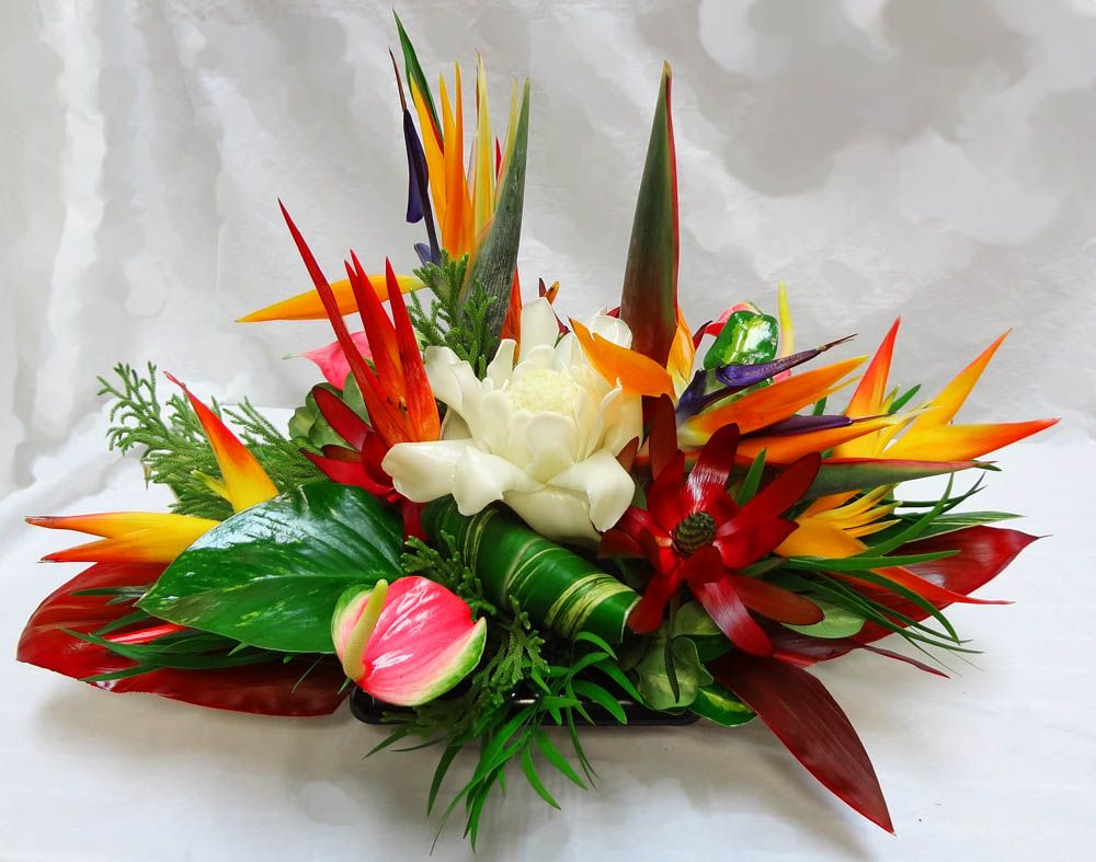 Photos of long low tropical floral centerpieces