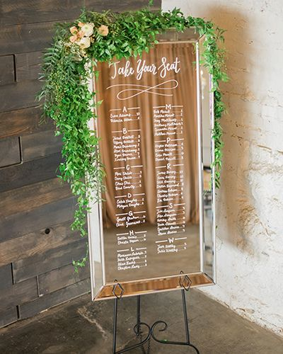Denver Chair Rental wedding signage: hand lettered mirror seating chart with leafy