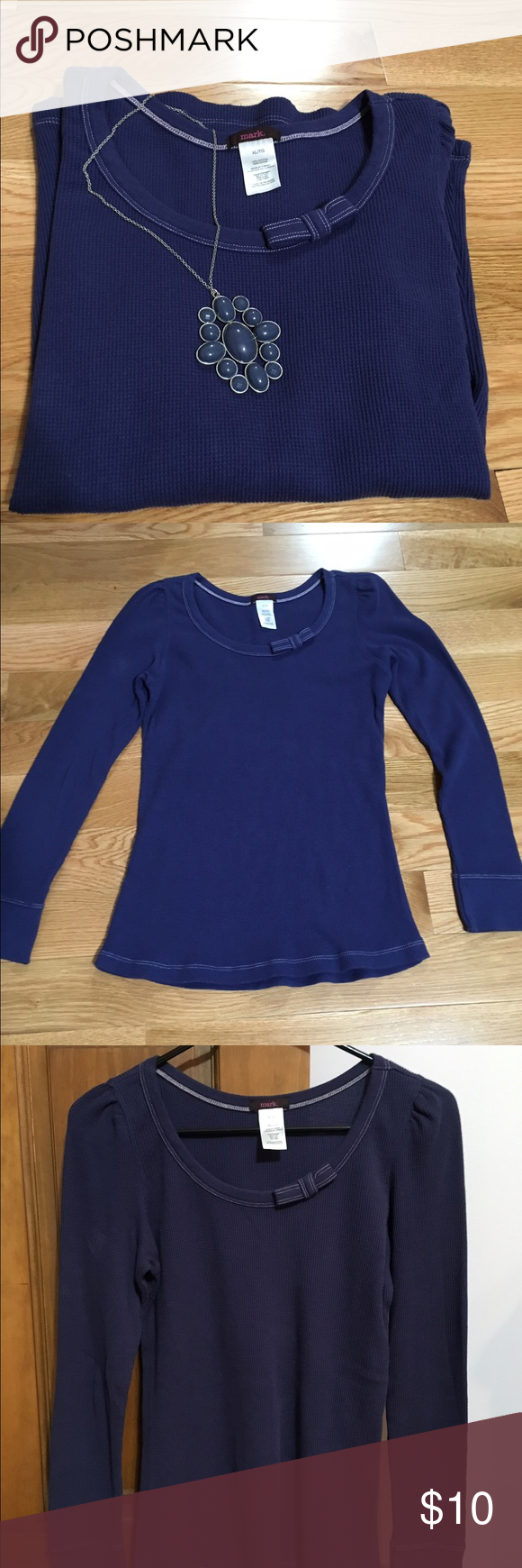 Mark Shirt This is a junior sized XL navy blue shirt by Mark (Avon).  It has never been worn because I wear a woman's XL and needless to say it did not fit.  It is a darling shirt with a bow on the collar. Avon Tops