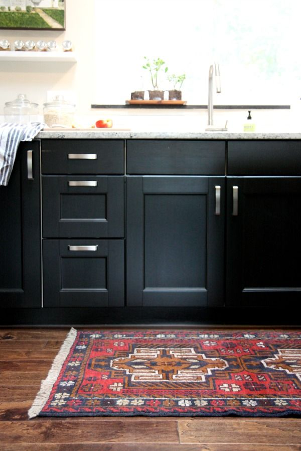 Black kitchen cabinets, marble benchtop, rug... | Black ...