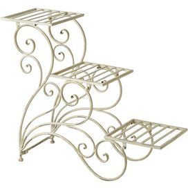 "Display your favorite greenery, blooms, and herbs with this charming iron plant stand, showcasing a white finish and scrolling design.   Product: Plant stand Construction Material: IronColor: WhiteFeatures: Scrolling design Three tiers  Dimensions: 30.5"" H x 25.5"" W x 10.5"" D"