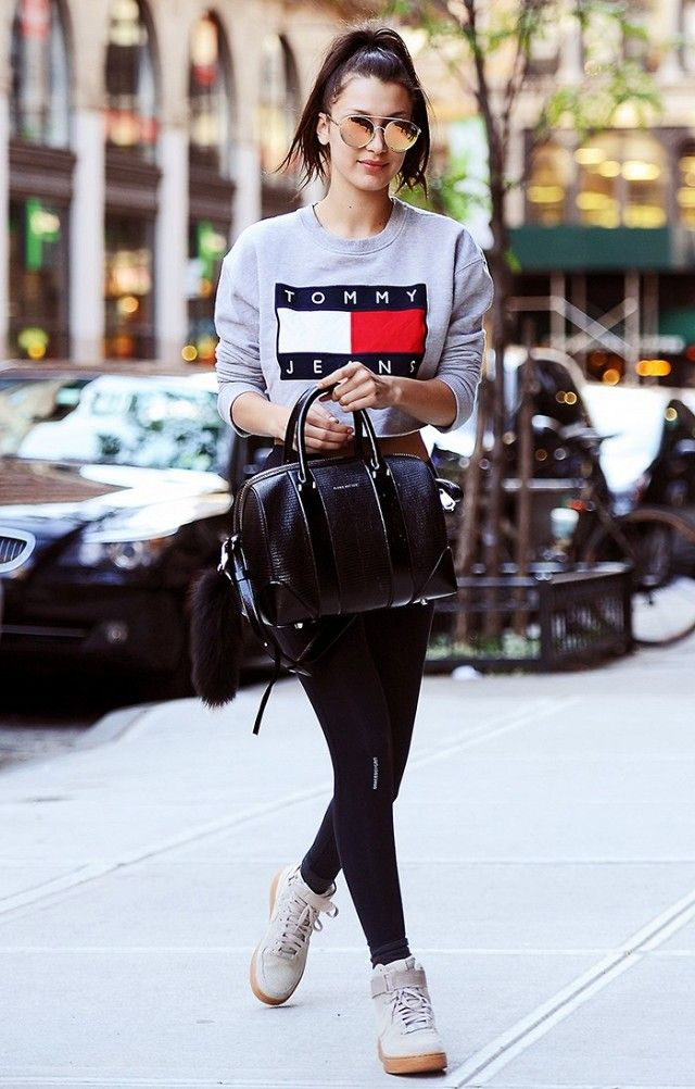 3b09e7cb3ef30 Bella Hadid adds that cool factor to her leggings look with a structured  bag, wedge sneakers, and reflective sunglasses.