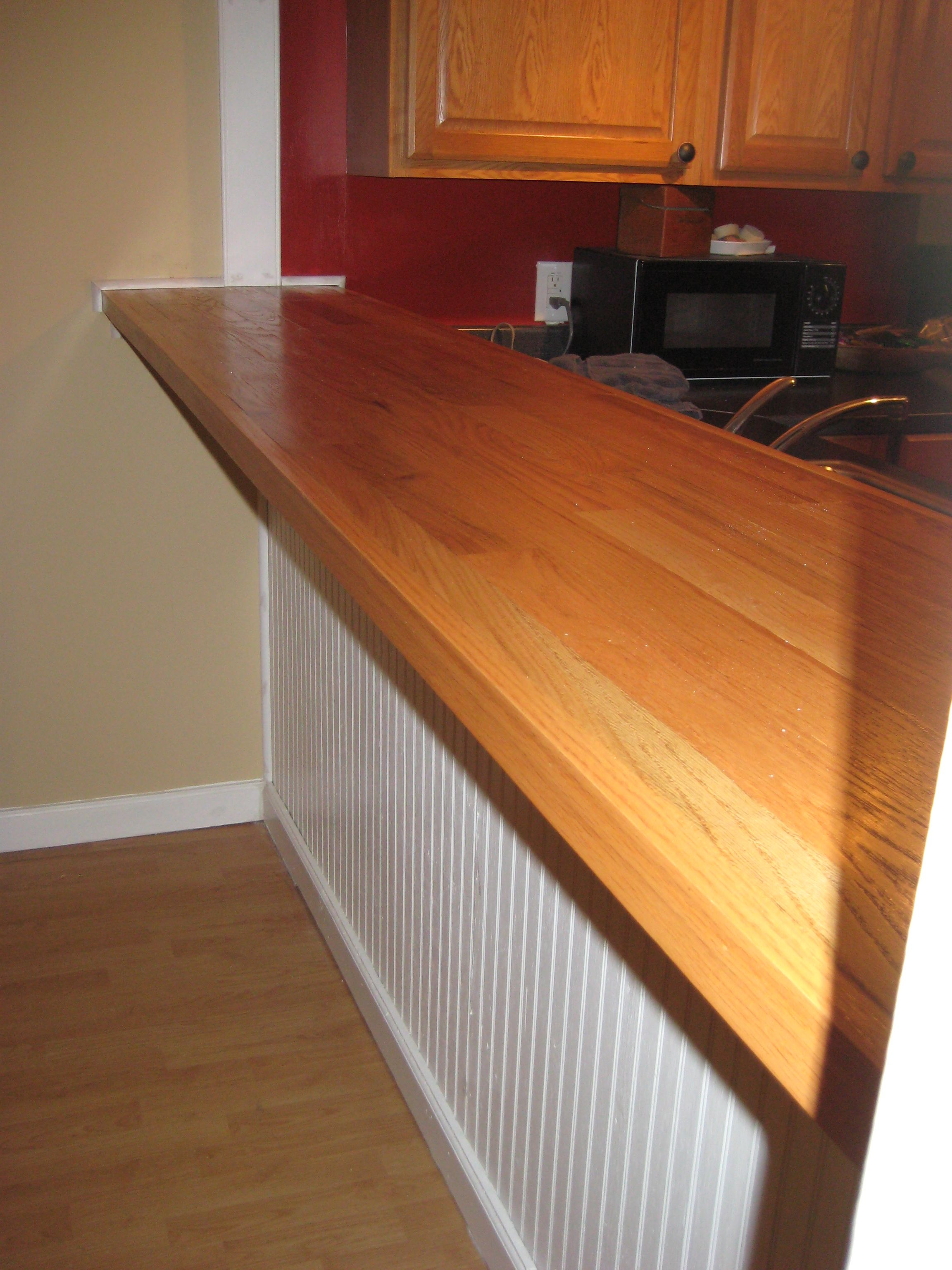 DIY bar top made with plywood, oak hardwood flooring, nail gun ...