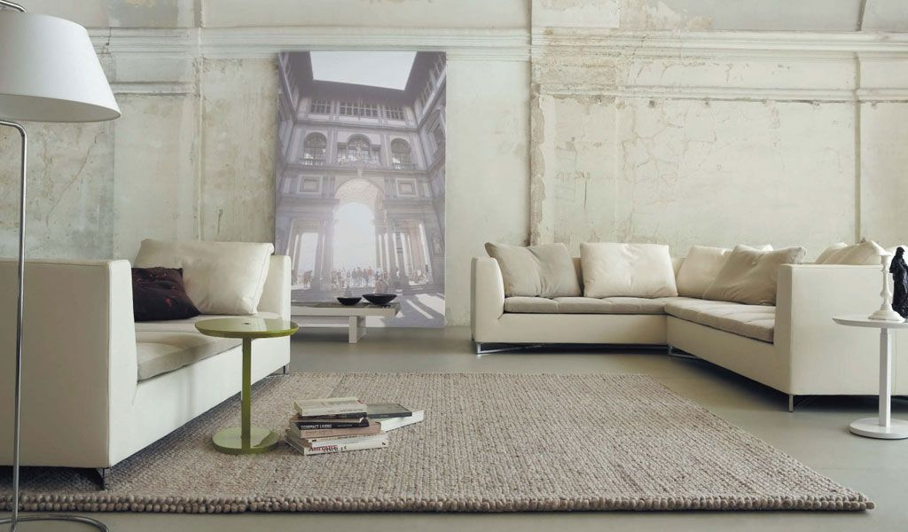 minimalist urban loft living room with cream sofas and light brown